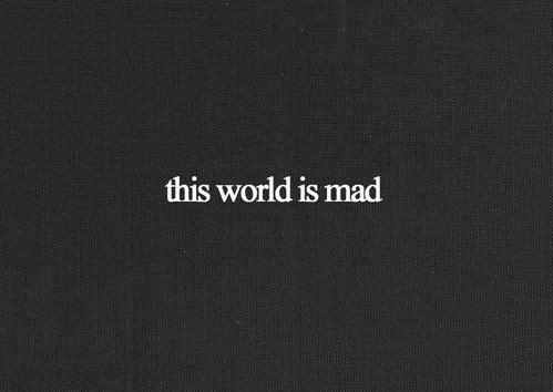 black and white, film, hipster, indie, is mad, movie, photography, quote, retro, text, this world, vintage, words
